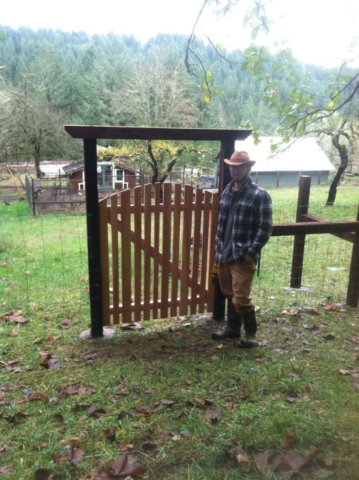 Alex completes a cedar gate for the upper orchard