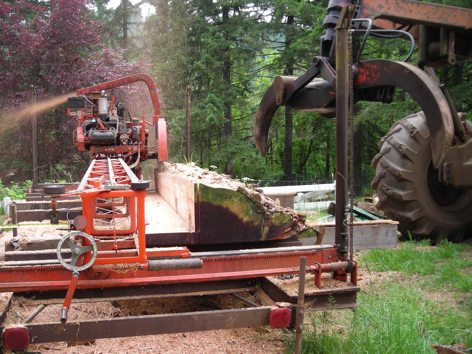 Cutting a 2-1/2 inch slab from the center of a redwood log while producing dimensional lumber